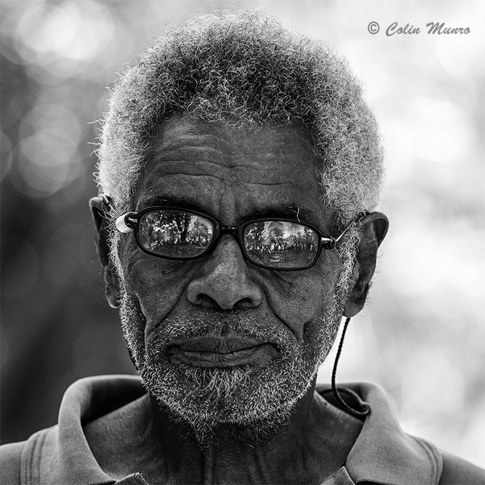 Old man in village Papua New Guinea photographed by Colin Munro